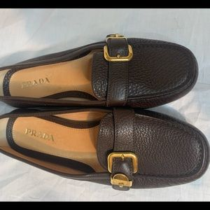 New brown Prada loafers.